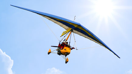 Flex-Wing Microlight Flying in Bedfordshire