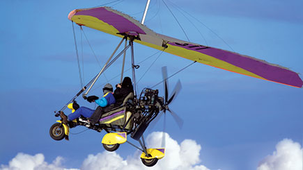 Extended Flex-Wing Microlight Flying in Bedfordshire