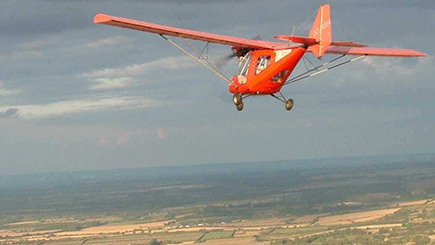 Extended Fixed Wing Microlight Flying in East Riding